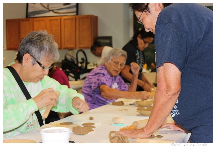Photo of women cutting cookies.